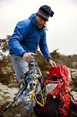 man unpacking climbing gear in palisades