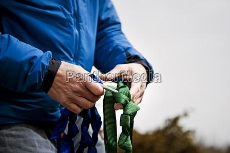 a mans hands work with climbing