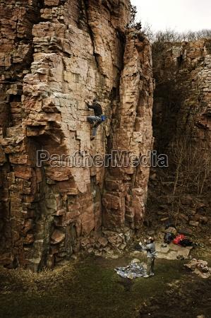 a man sport climbs at palisades