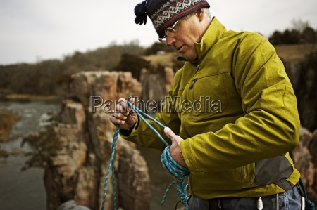 a man packs climbing gear at