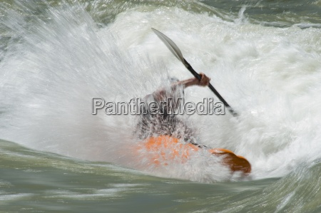 a whitewater kayaker is a blur