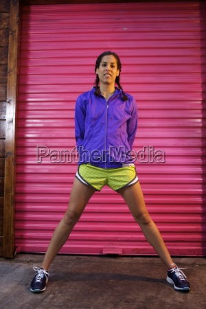 young female runner wearing purpler jacket