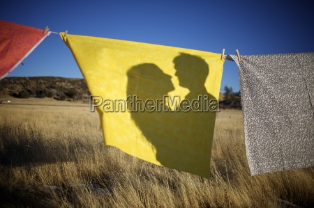a couples shadow on a yellow