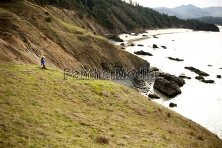 a woman hiking along a trail