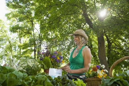 a young woman picks out flowers