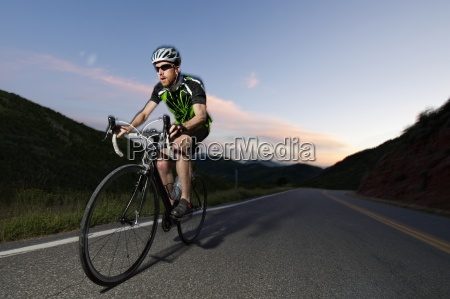 a road biker rides up east