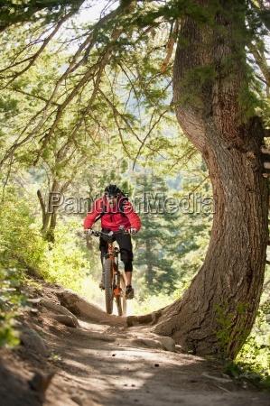 a young man rides his mountain