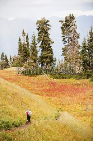 a woman trail runs through a
