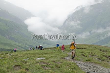 a group of hikers trek ot