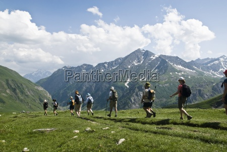 a group of hikers trek across