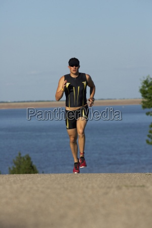 a male athelete running while training