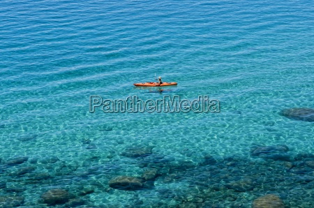 a single kayaker is out for