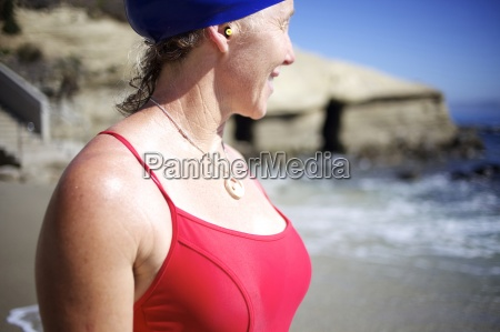 female swimmer looking at the ocean