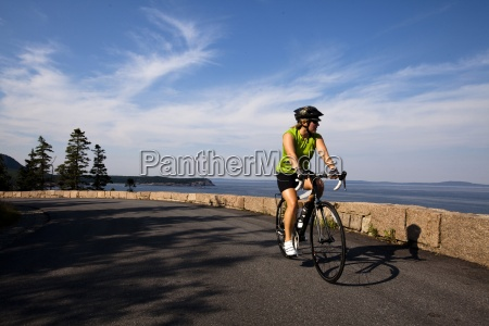 a female cyclist rides her road