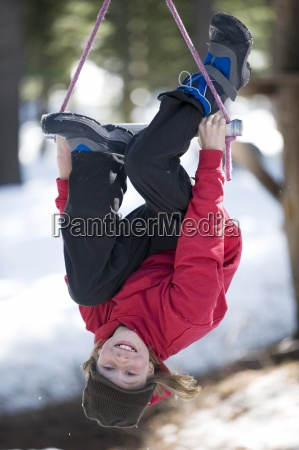 a boy ziplines over the snow
