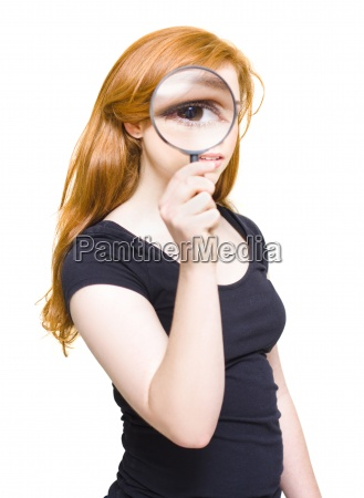woman holding looking glass or magnifying