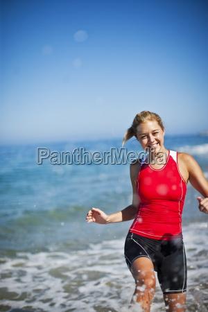 triathlon athlete running in the water