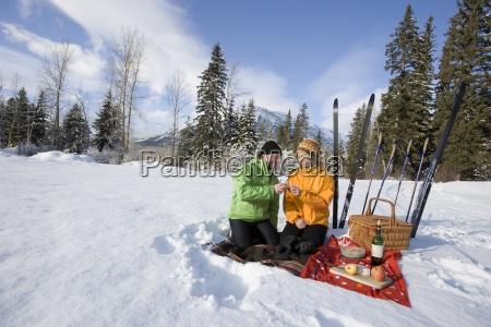 couple on picnic during ski trip