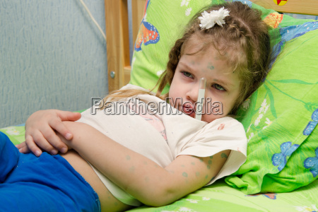 little girl lying in bed with