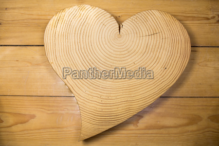 wooden heart against a wooden background