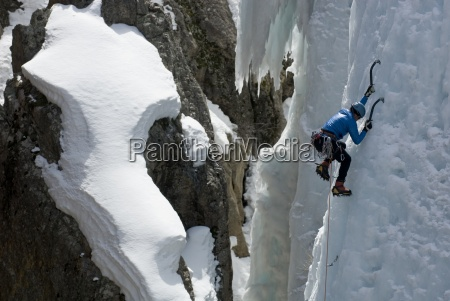 a woman ice climbing in the