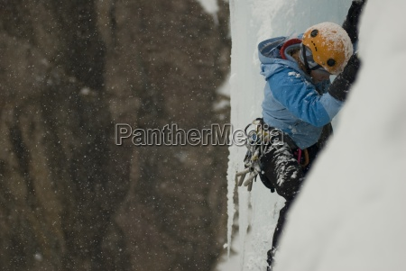 a professional female climber ice climbing