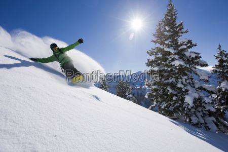 a snowboarder making some fresh tracks