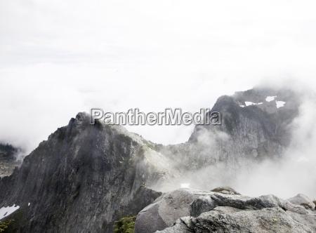 a peak on a foggy wet