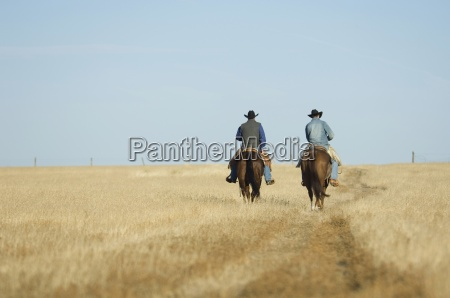 two cowboys on horseback in texas