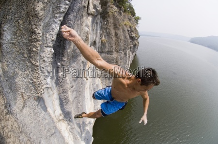a man falls from a cliff