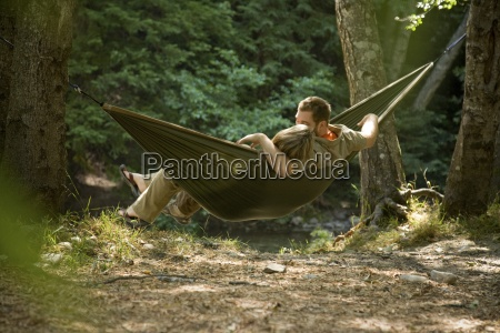 couple relaxing in a hammock in