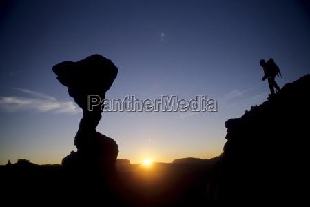 hiker and sunset near the cobra