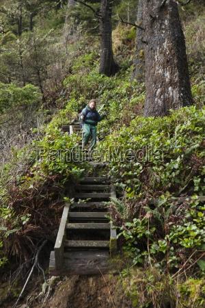a hiker walks down the wooden