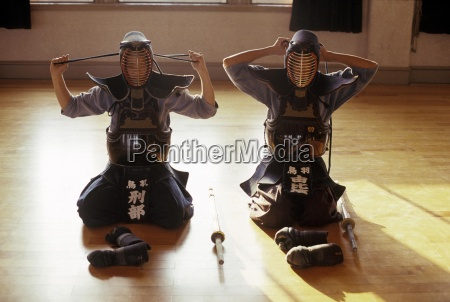 two young kendo players prepare for