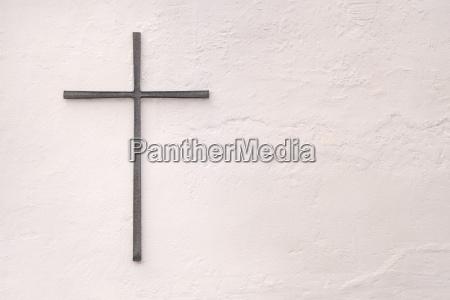 gray metal cross on a white