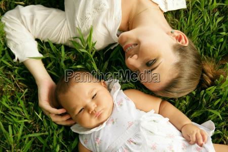 mother with caressing baby daughter laying