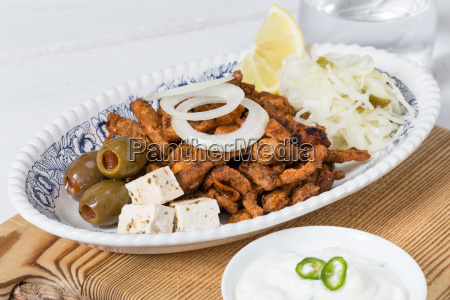 gyros with tsatsiki coleslaw olives and