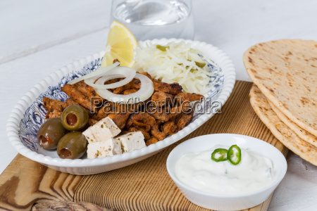gyros with tzatziki coleslaw olives and