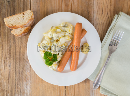 potato salad with sausages and mustard