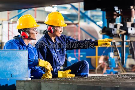 worker in factory at industrial metal
