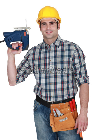 craftsman, holding, a, drill - 14039657