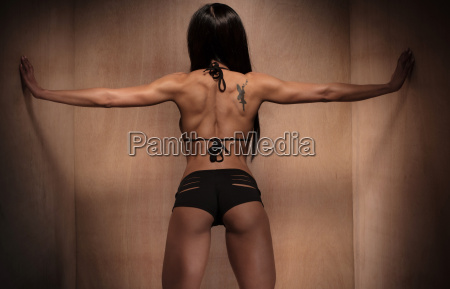 rear, view, of, an, athletic, woman - 14042123