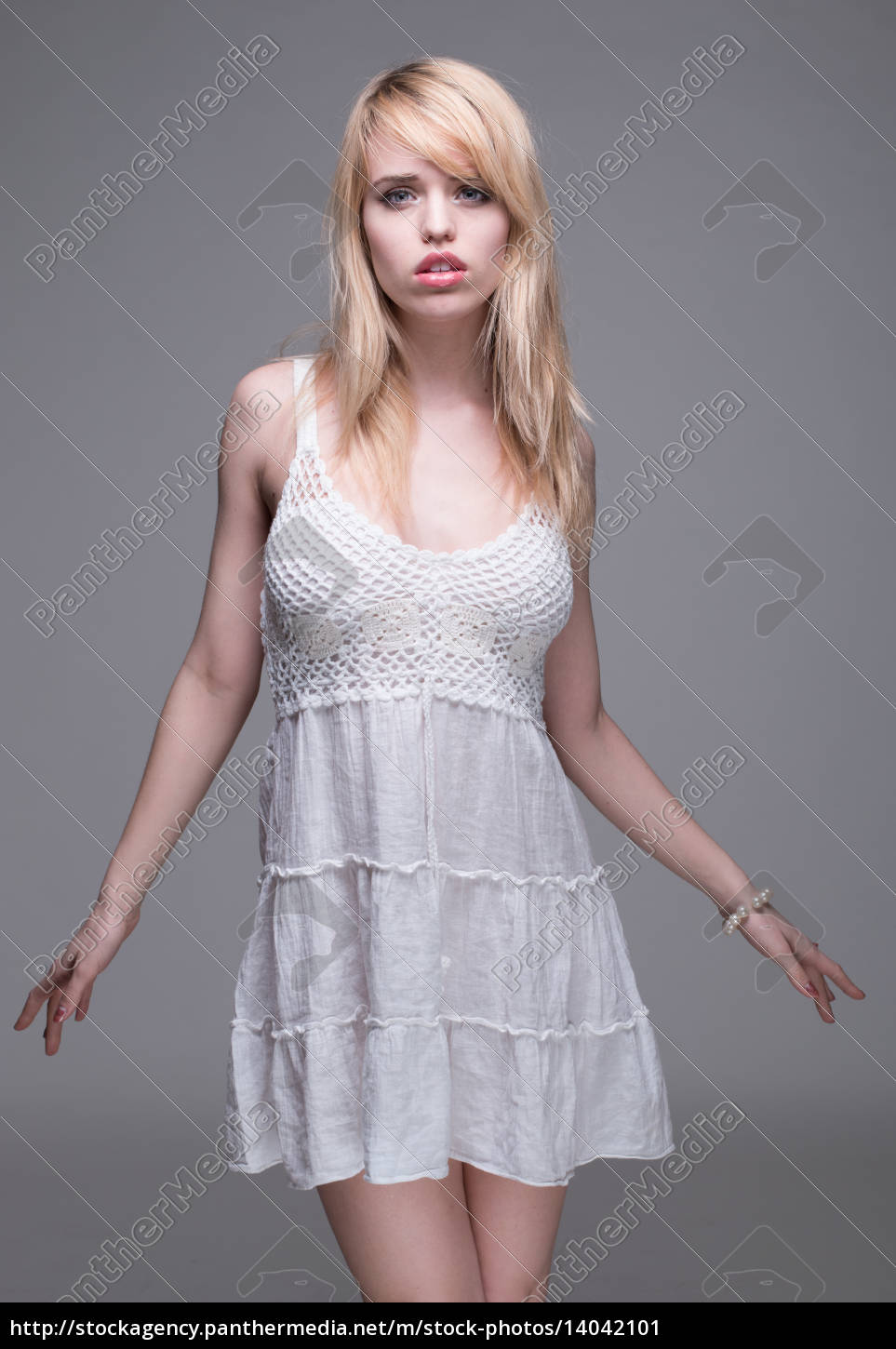 young, blond, woman, wearing, white, sun - 14042101