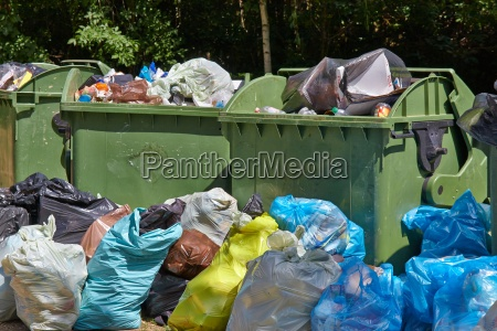 garbage containers full overflowing