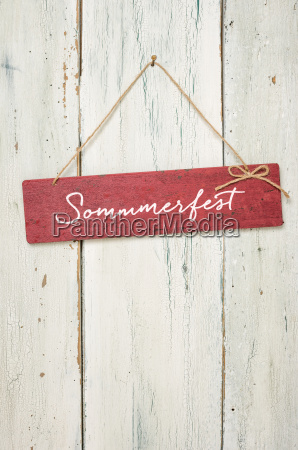 red wooden sign in front of