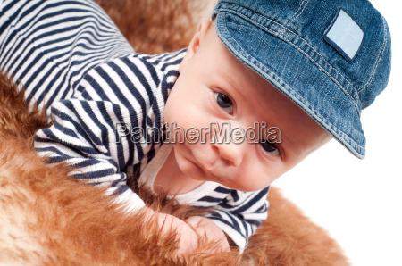 portrait of adorable baby in cap