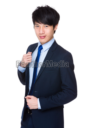 young, businessman, with, arms, crossed - 14047753