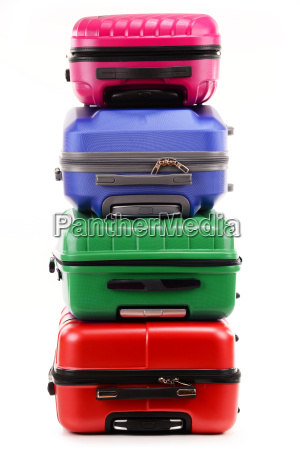 stack of plastic suitcases isolated on