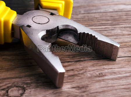 multitool, pliers, on, wooden, background - 14050731