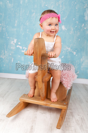 toddler on rocking horse